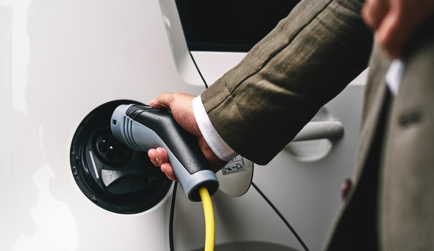 Plugging in EV charging cable