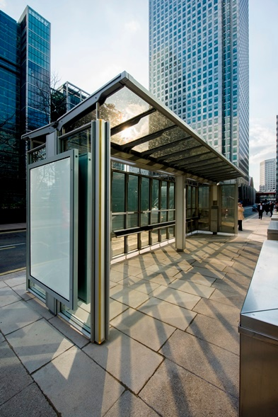 Bus shelter using solar glazing