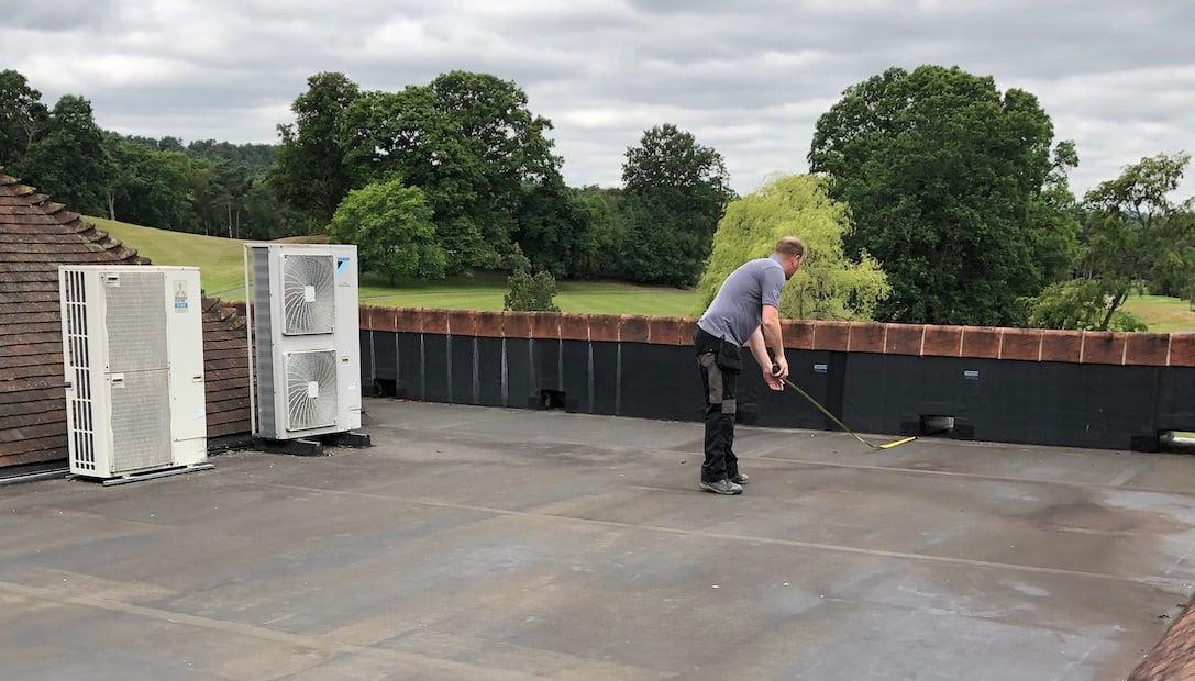 Justin measuring roof